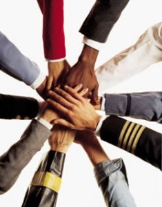 diverse group of hands joined together