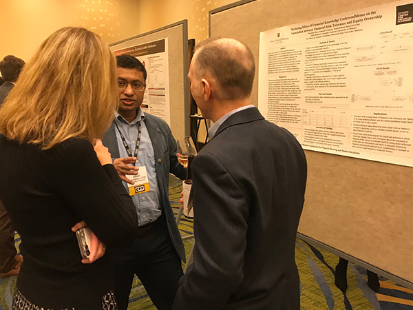 Dr. Rabbani with poster