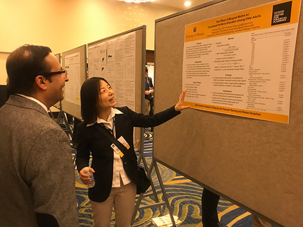 Dr. Yao with poster